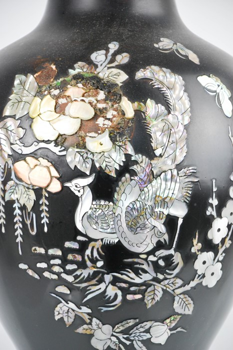 A Chinese black enamel and mother of pearl inlaid vase, depicting peacocks and flowers, 60cm high. - Image 2 of 2