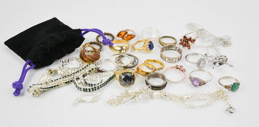 A group of rings to include silver examples, two crystal set bracelets, a ballerina pendant necklace