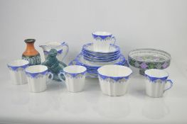 A Royal Stafford bone china part tea service together with a Poole pottery Otter , Sowerby pottery