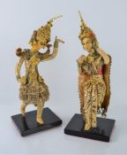 A pair of Indonesian figures on stands