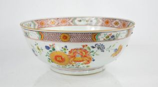 A 19th century Chinese enamelled bowl, depicting floral groups, and having an inner and outer