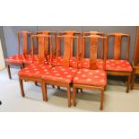 A set of eight Chinese rosewood chairs, including two carvers, and having red silk padded