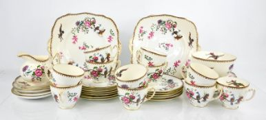 A Paragon china part tea service, comprising milk jug, cups and saucers, cake plates, slop bowl, and