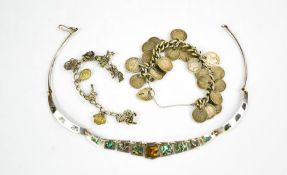 A mother of pearl and silver necklace, a charm bracelet and a silver chain link bracelet with
