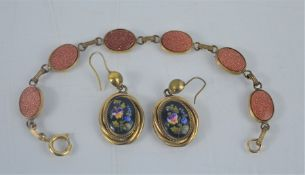 A bracelet and pair of drop earrings, painted with flowers.