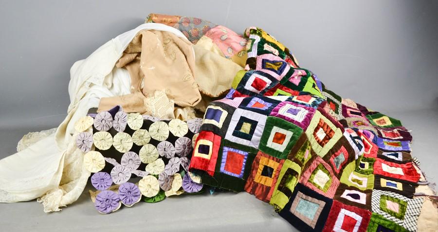 A patchwork quilt, tea cosy, vintage children's nightie, and Victorian nightgown.