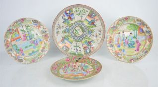 Three Chinese Famille Rose plates, 19th century, and a larger 20th century example. 24cm and 20.5cm