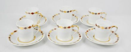 An Yves Saint Laurent set of six coffee cans and saucers