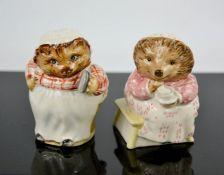 A Royal Albert Miss Tiggywinkle, and a Beswick Mrs Tiggywinkle, both 7½cm high.