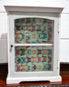 A painted pine cabinet with glazed door and single shelf, 55cm by 42cm by 18cm together with a