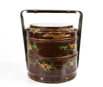A Chinese early 20th century hand painted wedding basket, depicting flowers on a red ground, 23cm