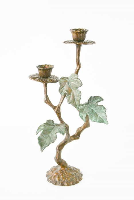 A bronzed candelabra in flower form. 20cms tall x 11cms wide