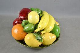 A pottery Italian majolica style model fruit bowl.