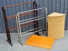 A chrome towel rail, a wicker linen basket, a wooden rail and a tray.