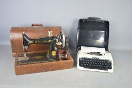 A vintage sewing machine and a 1940s typewriter.