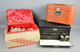 A sewing case with contents to include sewing accessories, and two vanity cases.