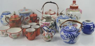 A group of Chinese and Japanese ceramics to include ginger jars, teapot etc