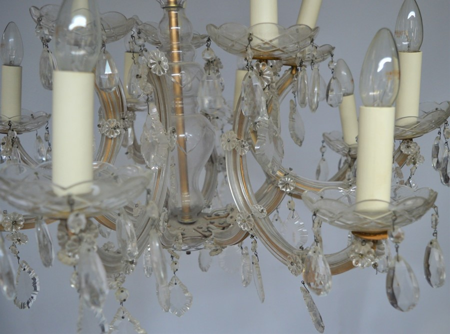 A French cut glass twelve branch chandelier, adorned with faceted beads and pear drops, 86cm - Image 2 of 3