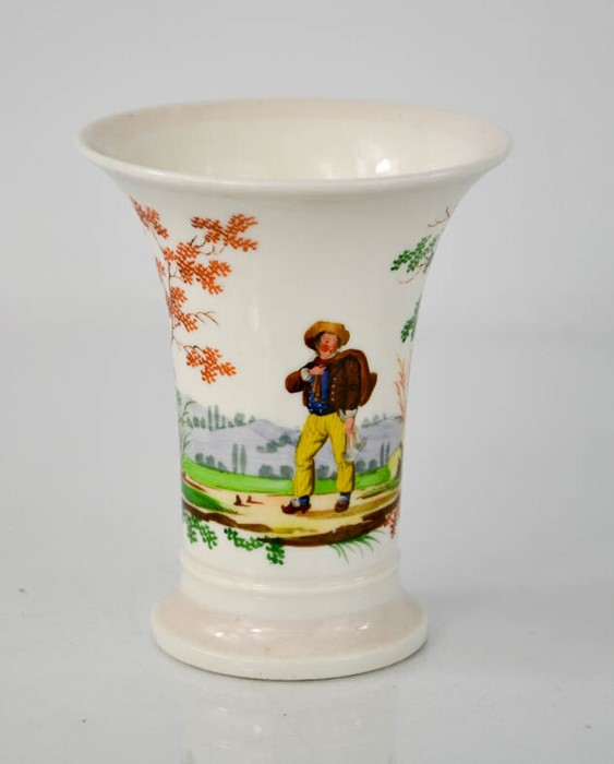A 19th century bud vase, depicting figure in landscape. 12.5cms tall x 10cms diameter on the rim