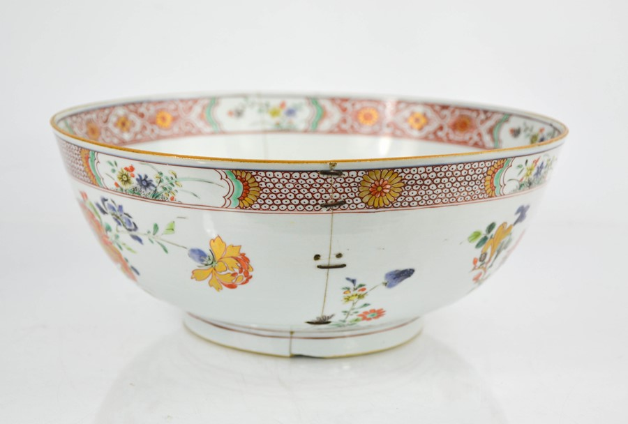 A 19th century Chinese enamelled bowl, depicting floral groups, and having an inner and outer - Image 2 of 3