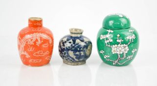 Three Chinese ceramic jars, including one green ground ginger jar and one with orange ground