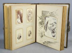 A Victorian postcard album, containing family portraits, leather bound.