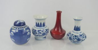A Chinese blue and white ginger jar with Prunus decoration together with a pair of blue and white