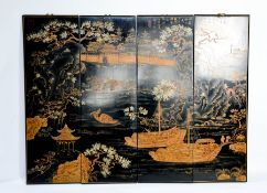 A set of four late 19th century black lacquered Chinese panels, depicting junks and town scenes