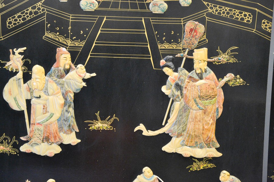 A large Chinese black lacquered tri-fold screen, depicting a Temple composed of carved soapstone, - Image 2 of 2