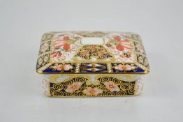 A Royal Crown Derby square shaped box and cover, date code 1913, on four feet 7cm high.