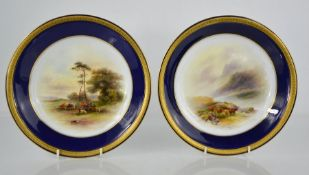 A pair of Royal Worcester dishes painted with cattle by John Stinton, with cobalt blue borders, date