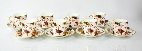 A set of eight Coalport china coffee cans and saucers.
