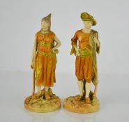 A pair of Royal Worcester blush ivory figures, Turkish man and woman, circa 1900, 22cm high.