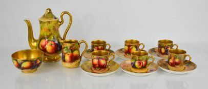 A Royal Worcester coffee set comprising six cups and saucers, milk jug, sugar bowl, coffee pot,