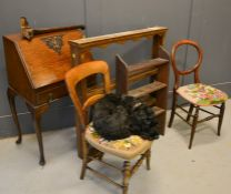 A group of furniture to include a small bureau, two Victorian chairs, and two bookcases.