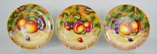 A fine set of three Royal Worcester plates, painted with apples, peaches, by P. Lynes, signed,