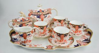 A fine Royal Crown Derby cabaret set comprising tray, milk jug, sugar bowl and cover, and four