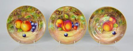 A fine set of three Royal Worcester plates, painted with apples, blackberries, peaches, by J Cook,