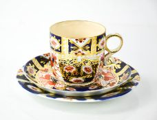 A Royal Crown Derby coffee can and saucer numbered 2451, and a trio in the Old Imari pattern.
