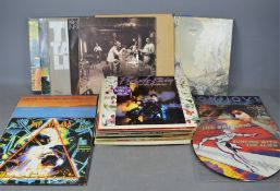 A quantity of LP records to include Yes, Bruce Springsteen, Joe Satriani, Led Zeppelin, Enya, Bon