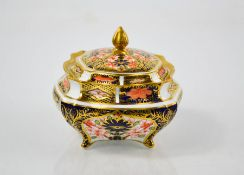 A Royal Crown Derby Old Imari pattern 2451 pattern box and lid, 10cm by 8.5cm.