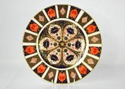 A Royal Crown Derby cabinet plate, in the Imari pattern, 1128, 27cm diameter.