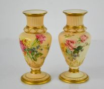 A pair of Royal Worcester blush ivory vases decorated with roses, 15cm high.