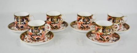 A set of six Royal Crown Derby cups and saucers, in the Old Imari pattern.