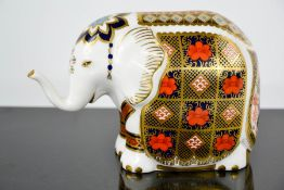 A Royal Crown Derby paperweight, in the form of an elephant.