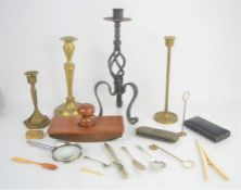 A silver tea spoon, salt spoon, knife, bone glove stretchers, blotter, and a group of candlesticks.