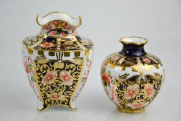Two Royal Crown Derby Old Imari pattern vases, one with crinkled edge, date codes 1912 and 1914.