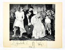 A family photo commemorating the Christening of Prince Edward, signed Elizabeth R and Philip 1964