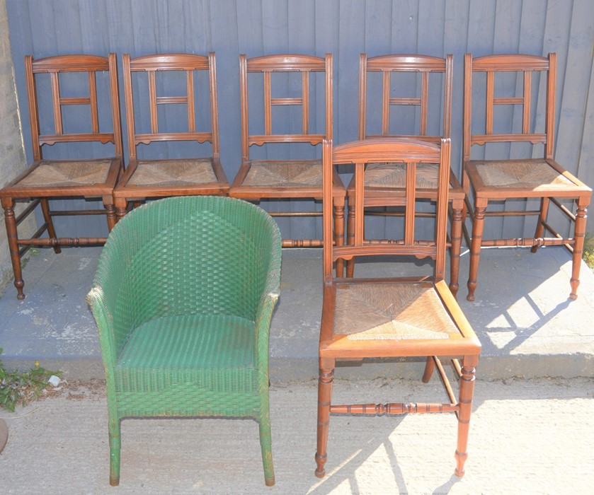A set of six antique chairs and a Lloyd Loom chair.