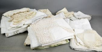 A quantity of linen and lace to include tablecloths, napkins, tray cloths, coasters, collars, mats